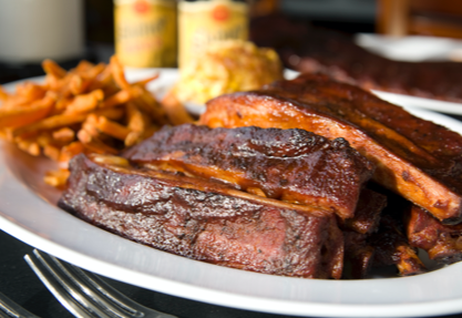 BBQ ribs on a white plate.