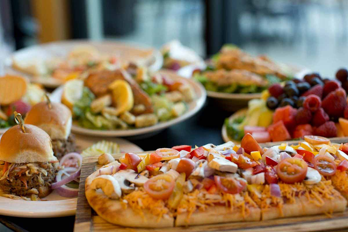 Pizza, pulled pork sandwiches and salad.