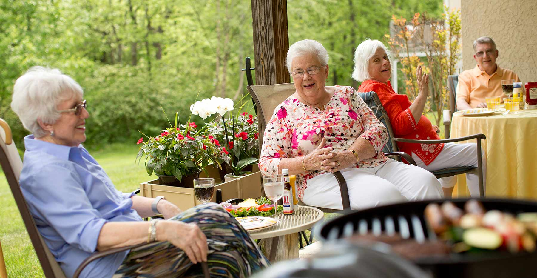 Two women sitting outside at Kingswood Senior Living Located in Kansas City, MO.