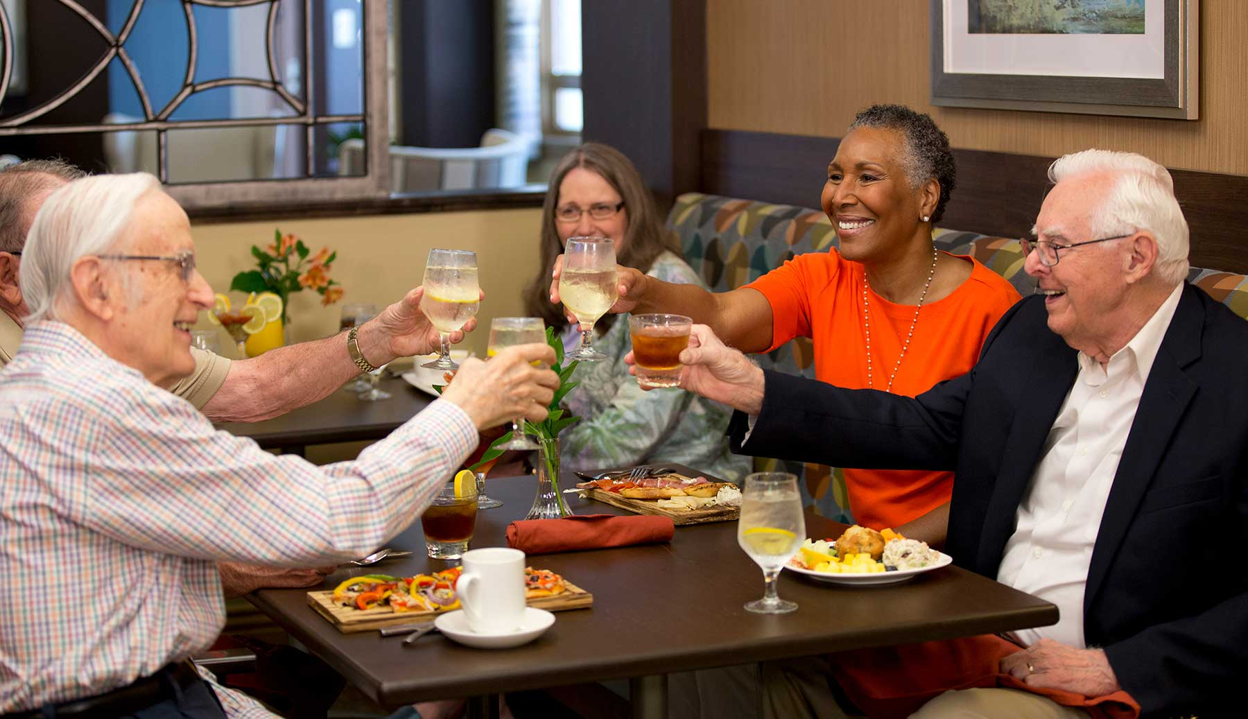 Three couples enjoying dinner in the bistro of Kingswood Senior Living Located in Kansas City, MO.