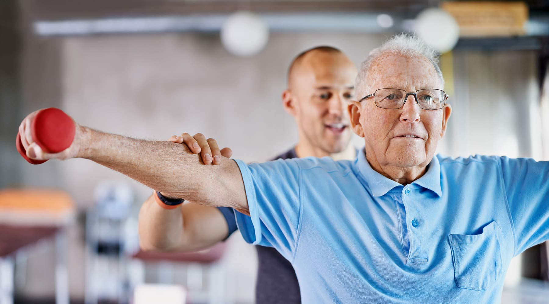 A man going through physical therapy at Kingswood Senior Living Located in Kansas City, MO.